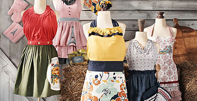 collection of vintage aprons with motifs from the 60s