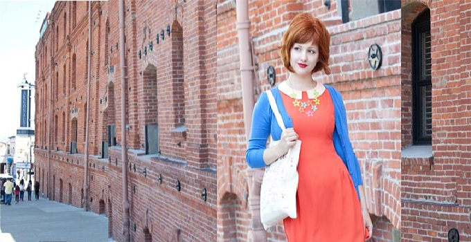 brightly colored mid mod clothing in front of brick