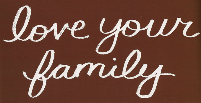 love your family written in white on a chocolate brown backdrop