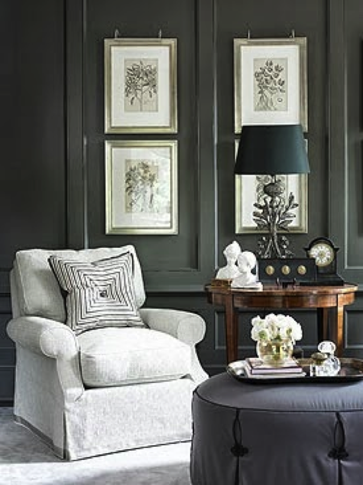 ornate table lamp topped with a black empire shade
