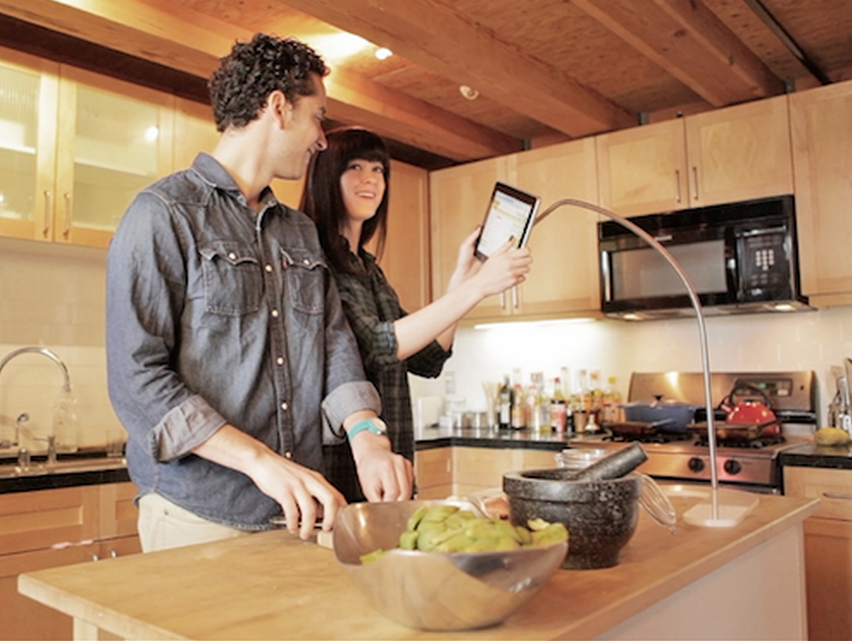 Man and Woman looking at a recipe on a tablet
