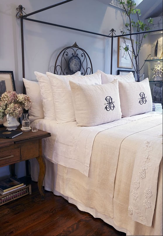 How to arrange large pillows on a bed with a duvet