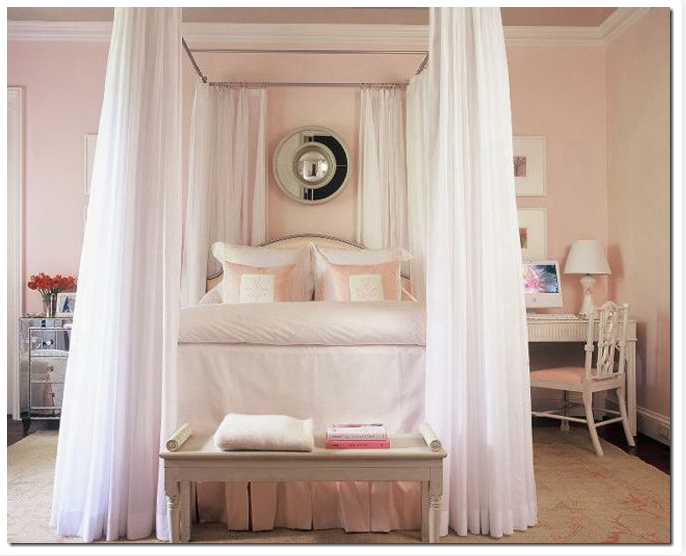 Beautifully arranged pillows on a canopy bed in pink and white