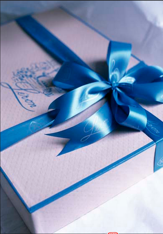 Blue linen gift box with bow