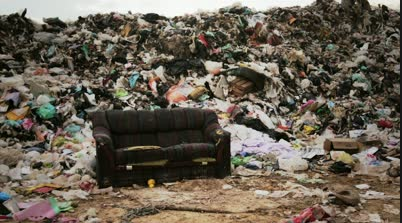 Old couch in a landfill photo