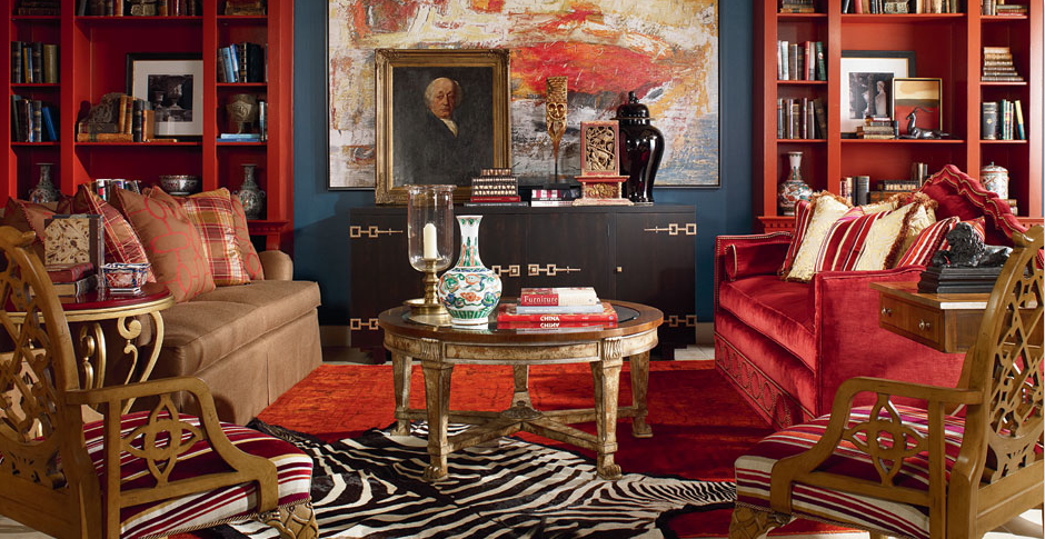 Red themed sitting room with down sofas