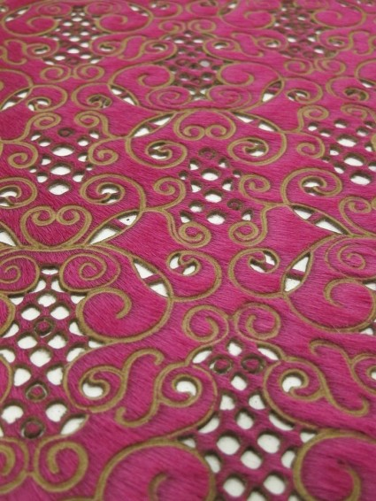 dyed pink and laser cut and embossed with gold