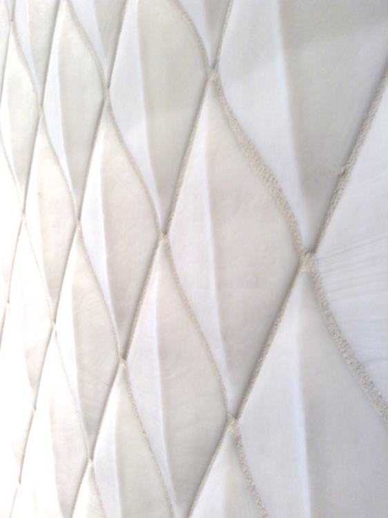 Photo of white quilted tile in kitchen showroom