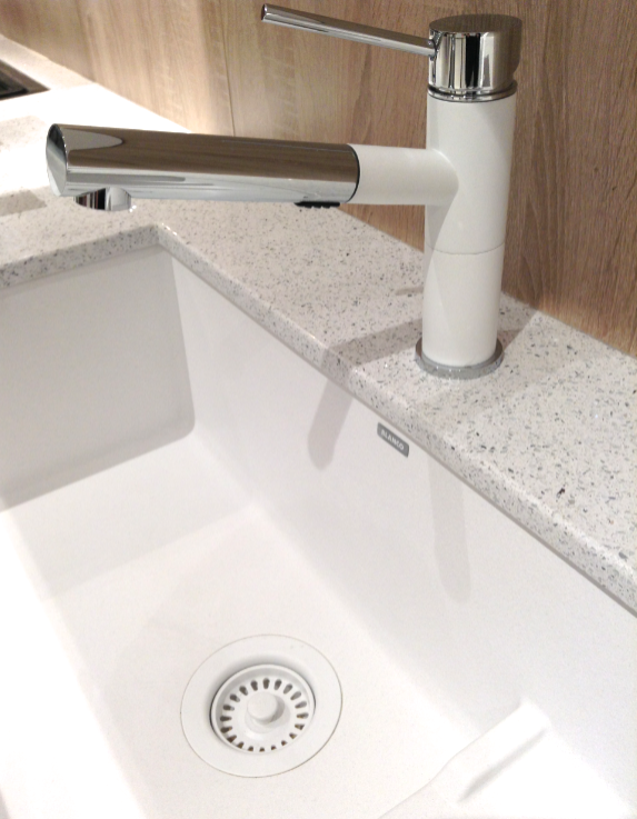 Blanco sink with white drain photo