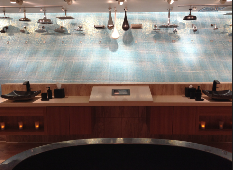Wide array of shower heads in the bathroom showroom of Pirch photo