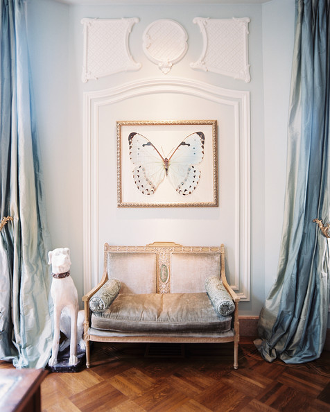Dramatic powder blue drapery reaches to great lengths, framing intricate moldings and antique seating - Lonny mag