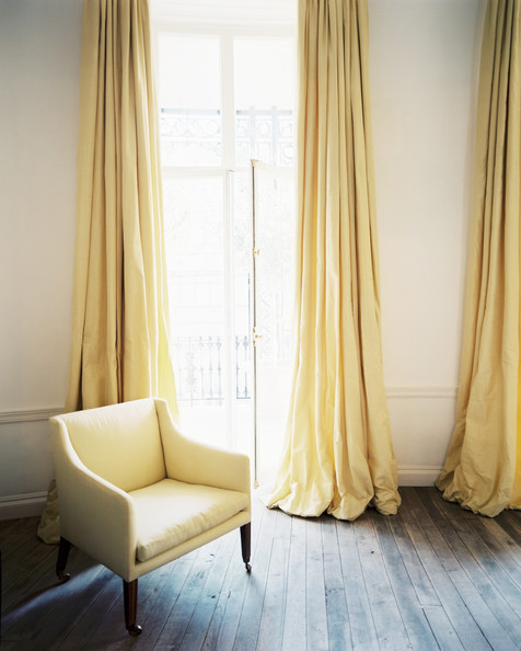 The best seat in the house is always near an open window—made even sunnier by the addition of buttercup drapery - Lonny mag