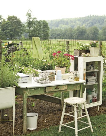 Potting station at garden's edge photo