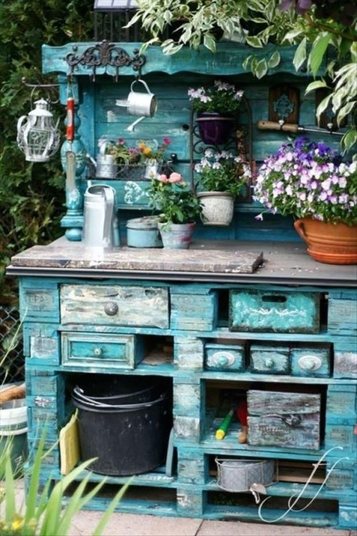 Blue potter's bench made from an old kitchen cabinet photo