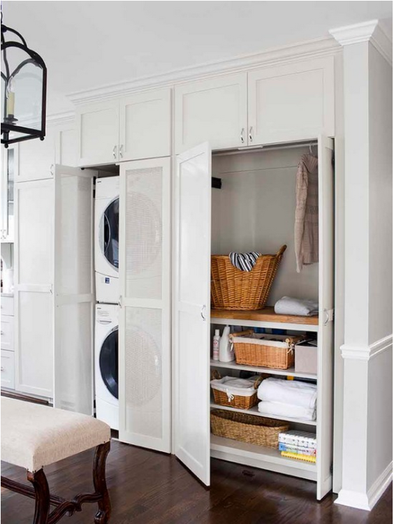 Lots of cabinets in a renovated laundry room photo