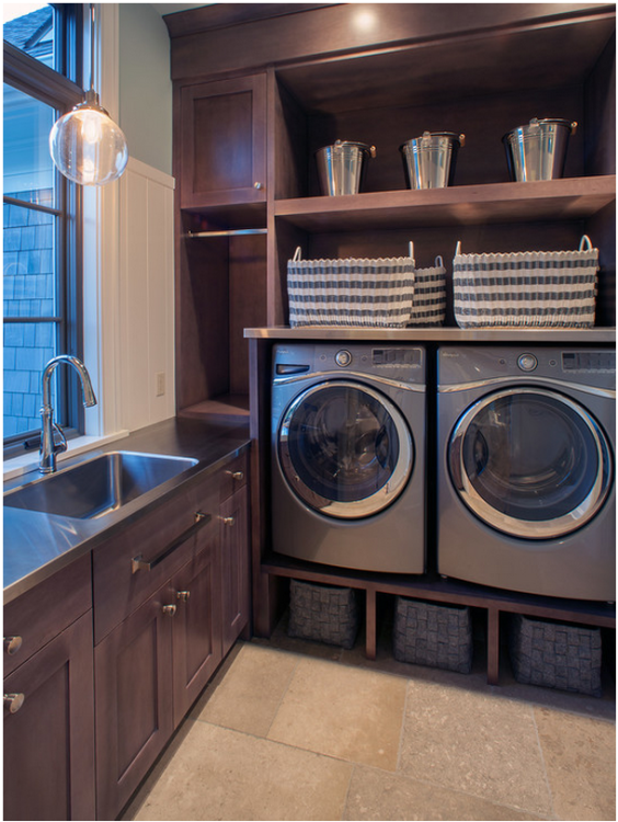 Wooden cabinetry in a luxury laundry room photo