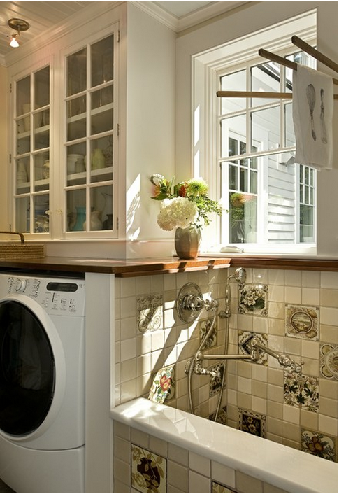 Slide out wood countertop in luxury laundry room design photo