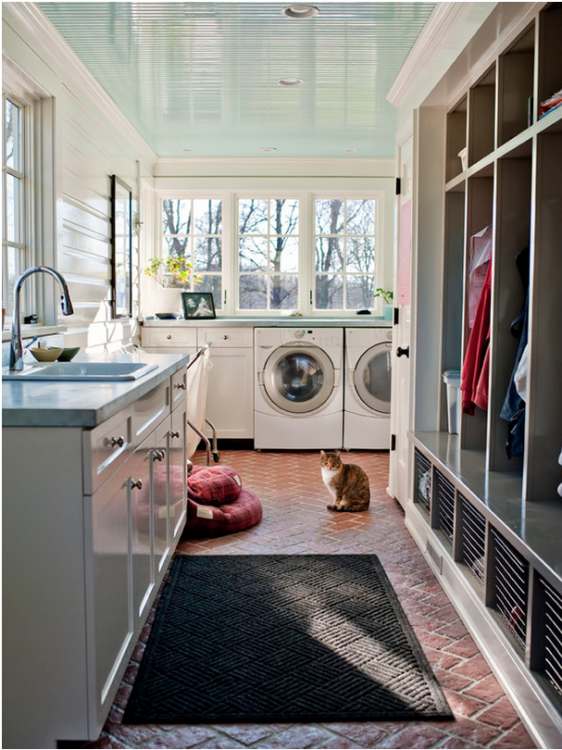 Luxury laundry room with brick flooring and large space photo