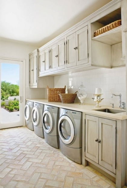 Luxury laundry room with brick flooring photo
