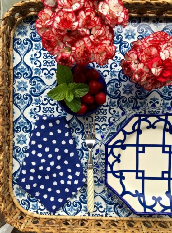 Beautiful Red Flowers on a Blue and White place setting for 4th of July Decor