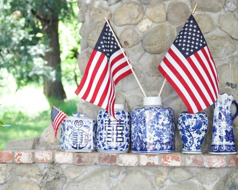 Blue and white ginger jars with American Flag