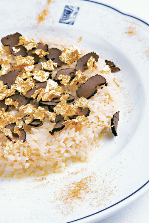 Champagne and Truffle Risotto with edible gold flakes photograph