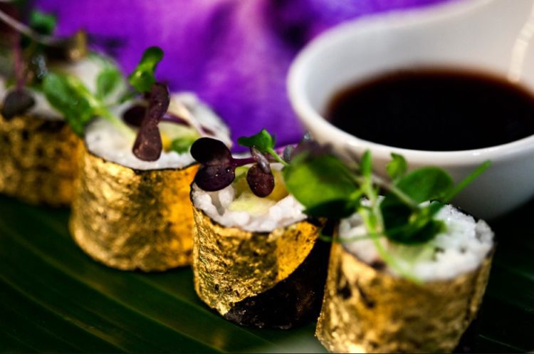 Edible Gold Leaf wrapped around sushi photo