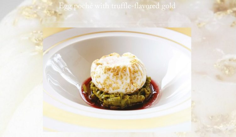 Egg poche with truffle flavored gold flakes photograph