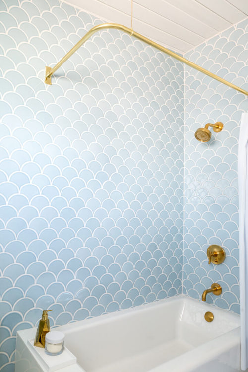Photo of Fireclay Tiles surrounding bath tub and shower