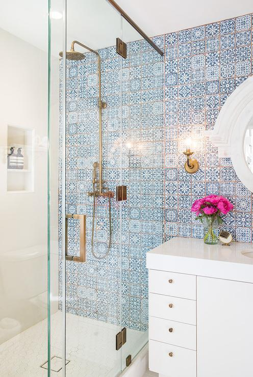 Photograph of accent wall of blue and white Moroccan tiles