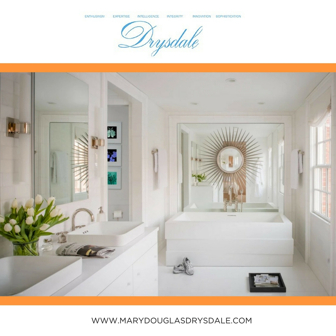 An elegant, bright white bathroom designed by Mary Douglas Drysdale.