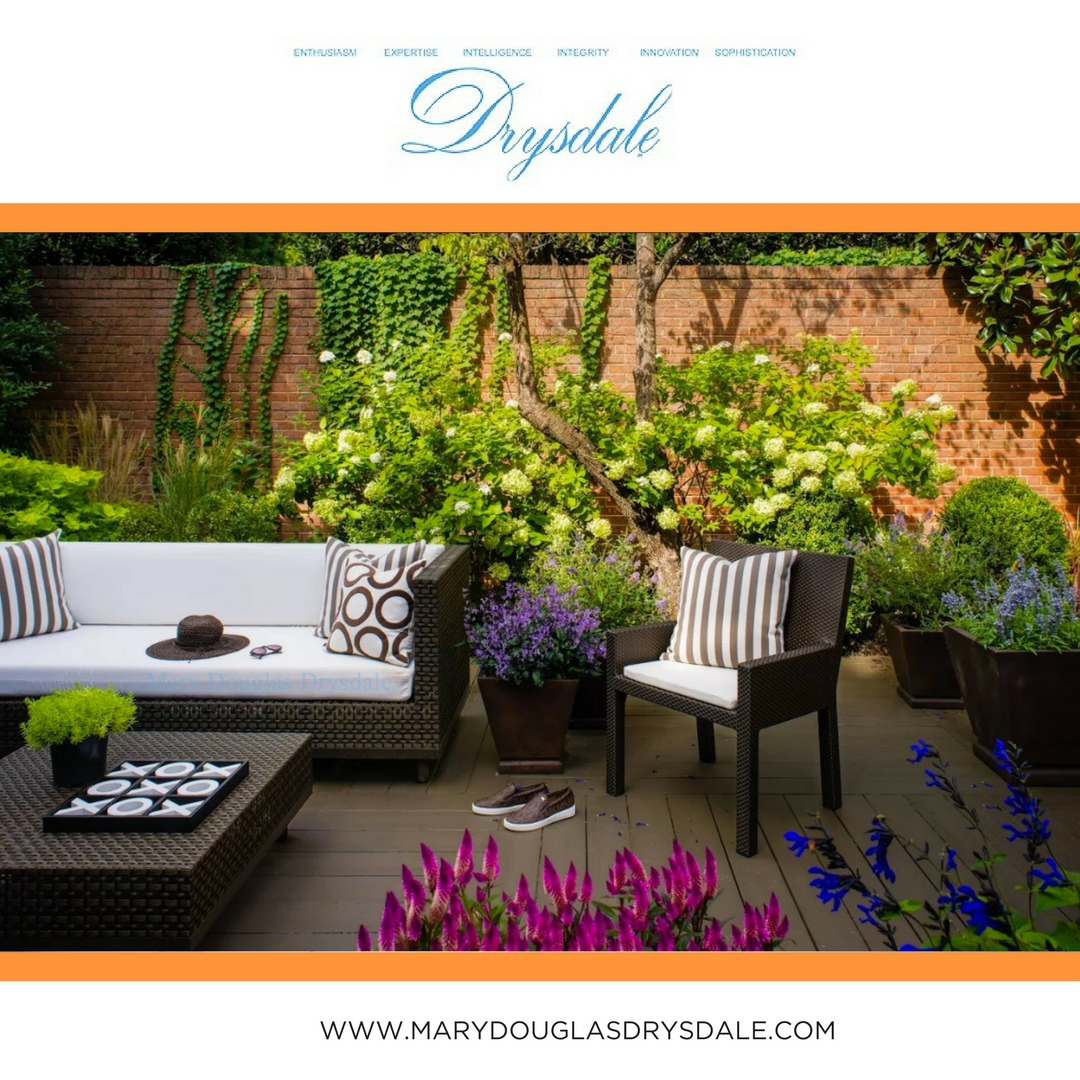 A beautiful indoor/outdoor living area created by interior designer Mary Douglas Drysdale for a client.