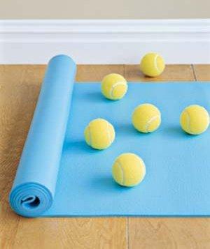 Tennis Balls on a mat