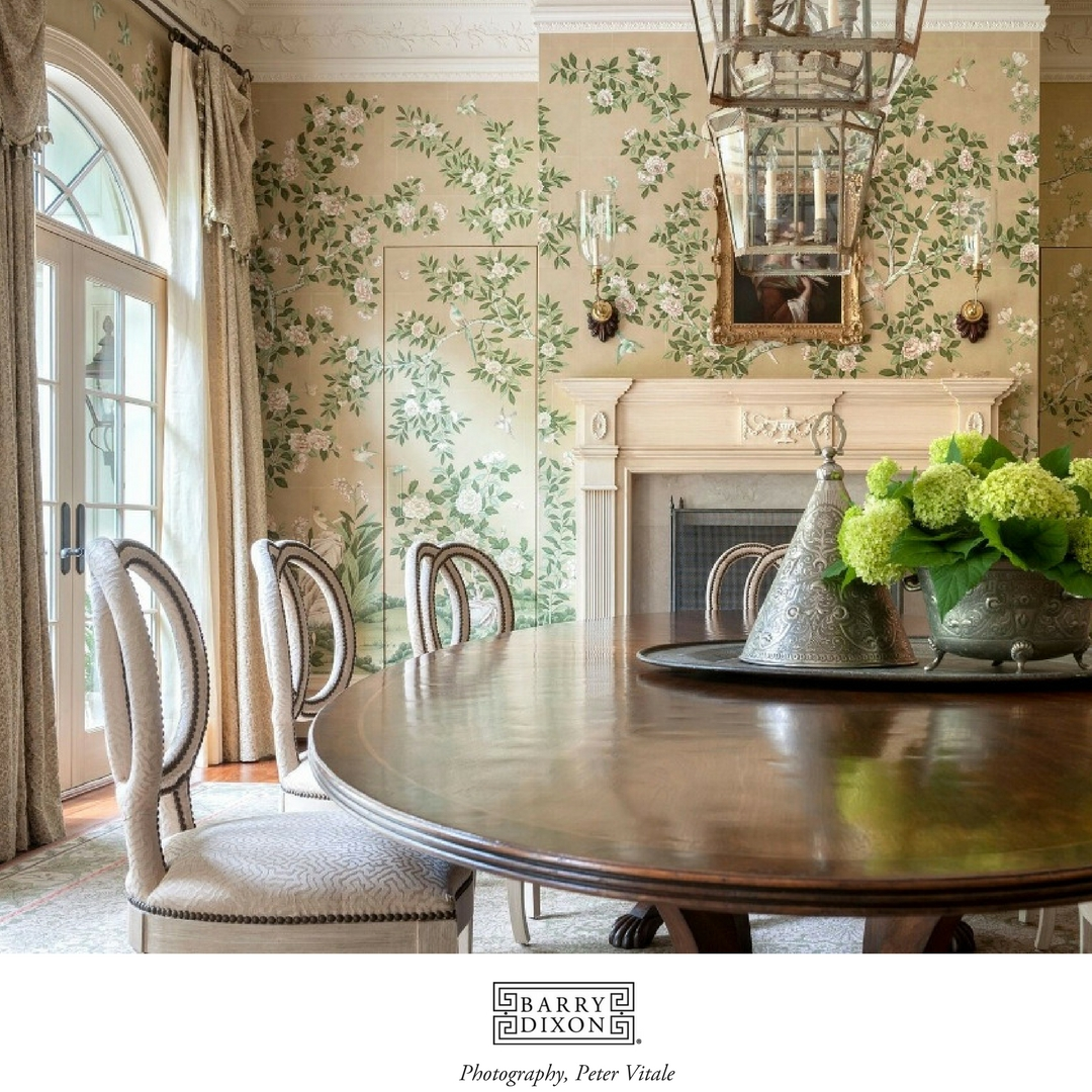 A beautiful dining room with handpainted wallpaper, designed by Barry Dixon and photographed by Peter Vitale.