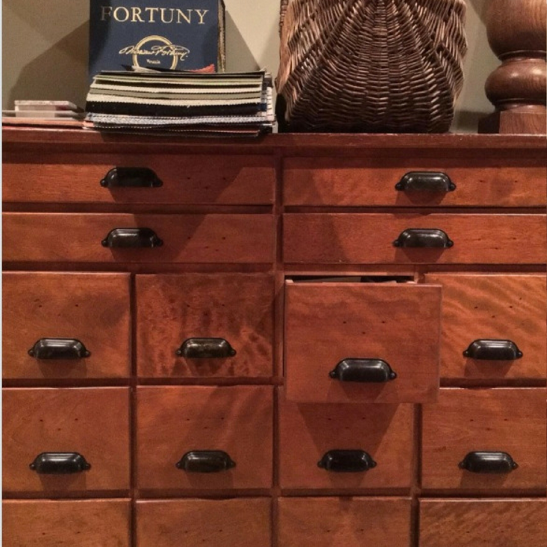 Antique wooden drawers are used to house the fabric samples used by the design offices of Barry Darr Dixon