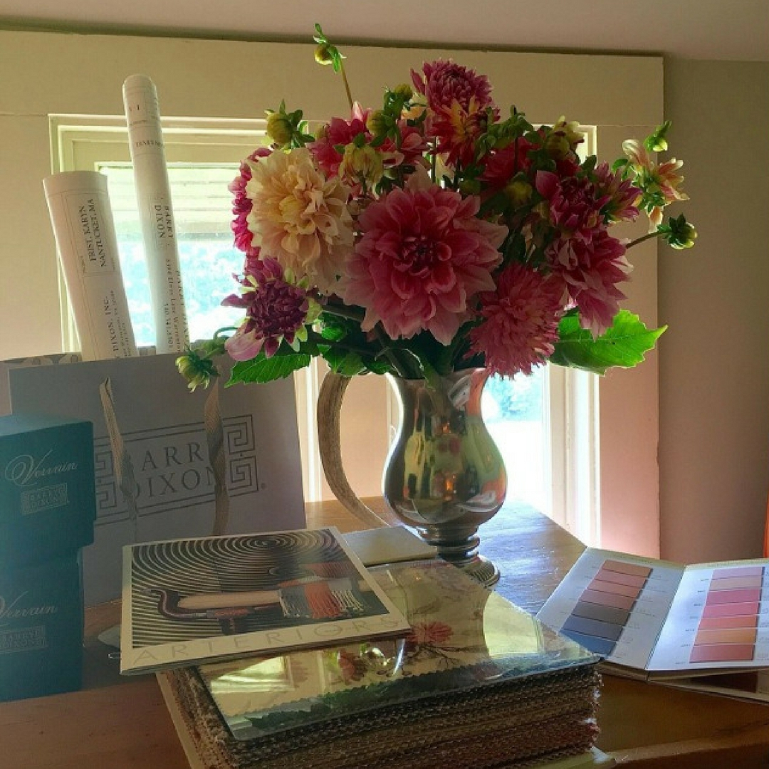 Barry Darr Dixon picks and arranges fresh flowers from his estate to greet his clients on the day of his presentations.