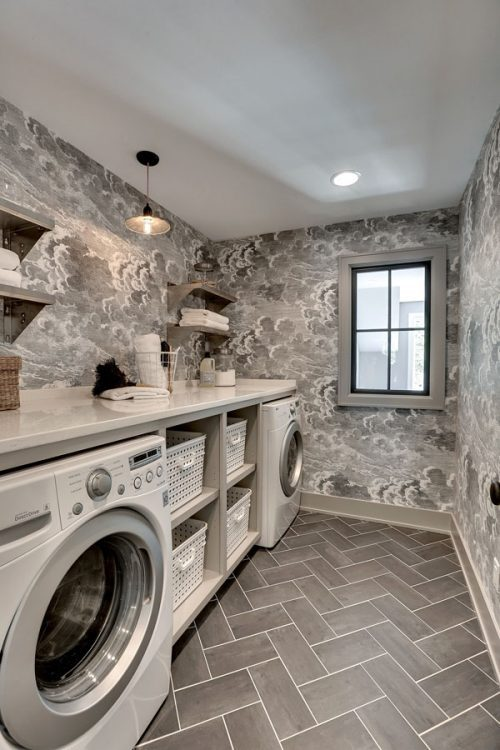 luxury laundry room ideas, include plenty of counter space and shelving. Click to see the rest of our tips for luxurious laundry room ins the post!