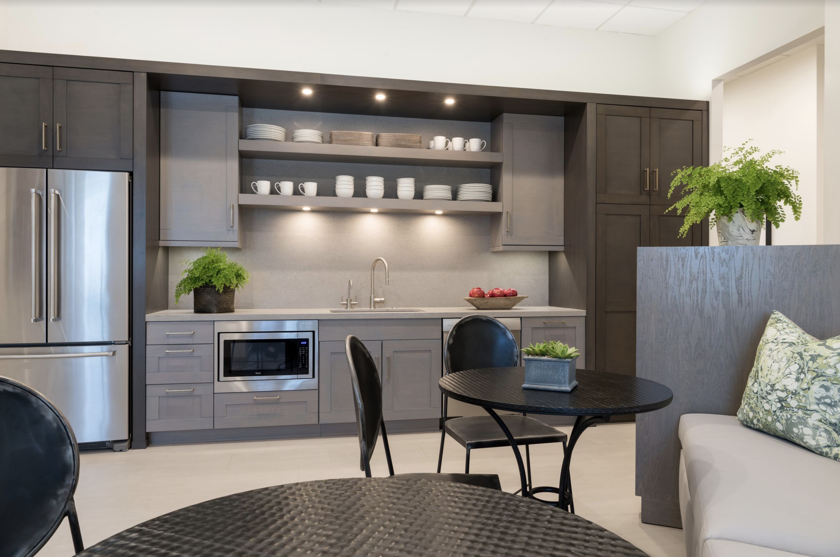 A functional, elegant kitchen serves as a brainstorming center for the team at Houston based Lucas Eilers Design Associates.