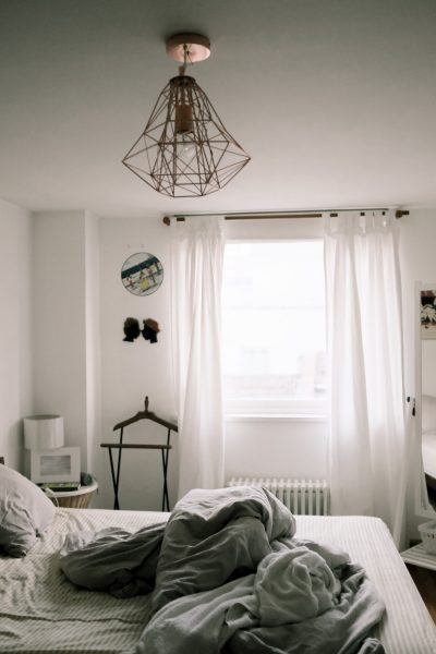 airy curtains in a bedroom pixels stock
