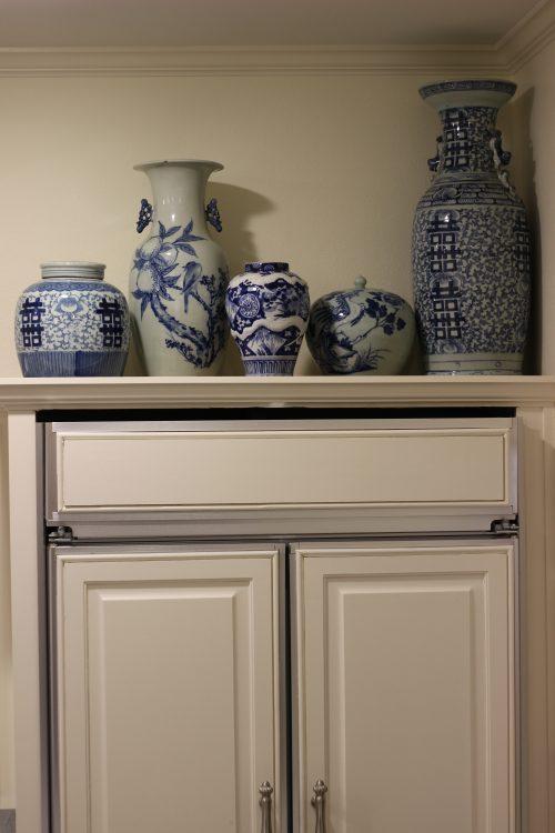 Ceramic art above kitchen cabinets