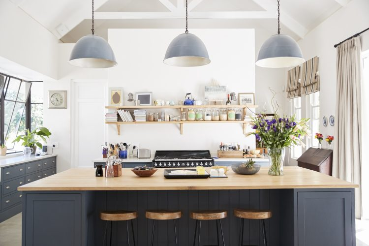 Use the space above your kitchen cabinets to display photographs and art