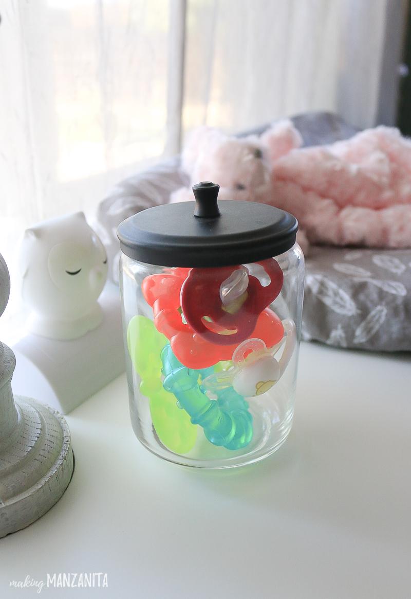 nursery organization ideas store pacifiers in jars