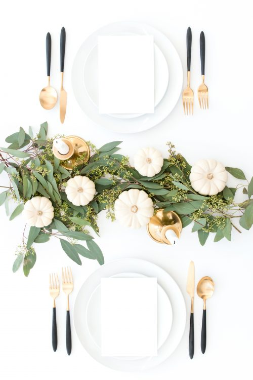 minimalist fall table top with white pumpkins