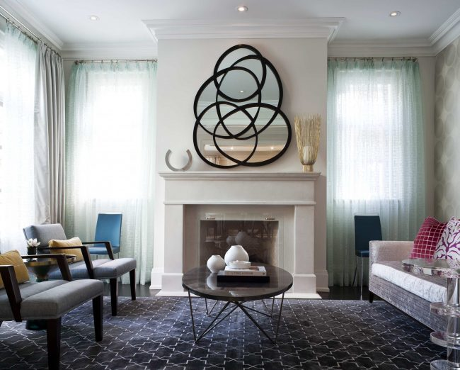mirror above fireplace mantel